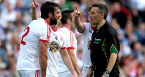 Tyrone's Joe McMahon argues with referee Maurice Deegan after he awarded Mayo's penalty during the All-Ireland SFC semi-final at Croke Park. Photograph: Ryan Byrne/Inpho
