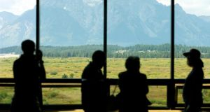 Mount Moran in Grand Teton National Park is seen through a window at the Jackson Hole economic symposium, sponsored by the Kansas city Federal Reserve Bank at the Jackson Lake Lodge in Moran, Wyoming.  Photograph: Price Chambers/Bloomberg
