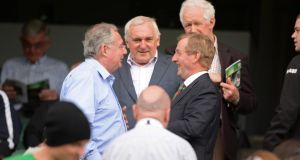 Taoiseach and Mayo supporter Enda Kenny (right) is congratulated by Minister for Communications Pat Rabitte at Croke Park yesterday as former taoiseach Bertie Ahern and his brother Maurice look on. Photograph: Dara Mac Dónaill / The Irish Times