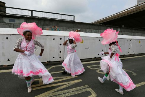 Performers during the children's day parade. Photograph: Stefan Wermuth/Reuters