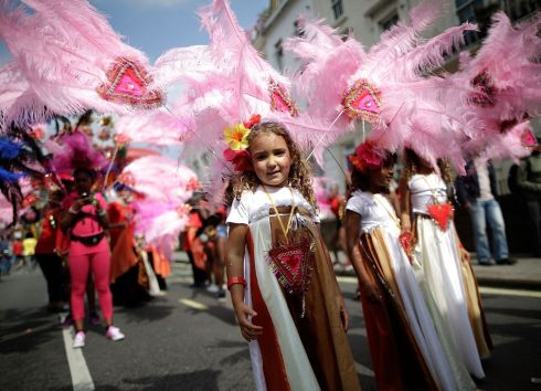 Revellers in costume take part in the Notting Hill Carnival in London. Photograph: Matthew Lloyd/Getty Images
