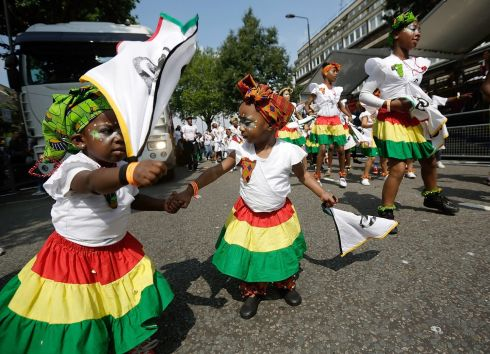 Children in costume dance on the street during the Notting Hill Carnival. Photograph: Matthew Lloyd/Getty Images