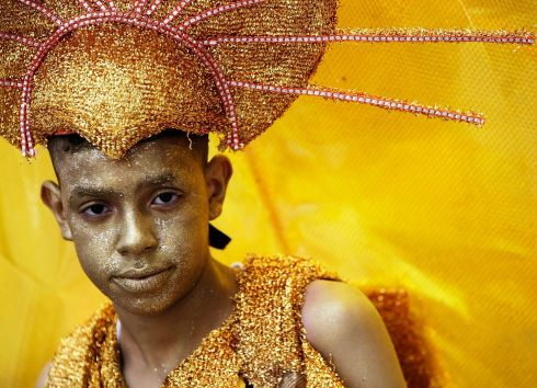 A boy takes part in the festivities at the Notting Hill Carnival. Photograph: Matthew Lloyd/Getty Images