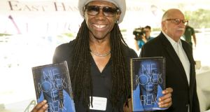 Nile Rodgers with his memoir Le Freak
