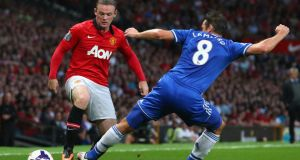 Chelsea target Wayne Rooney  is challenged by Frank Lampard at Old Trafford. Photograph:  Alex Livesey/Getty Images