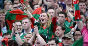 Mayo fans celebrate win against Tyrone during the All Ireland senior football championship semi-final at Croke Park on Sunday. Photographer: Dara Mac Dónaill/The Irish Times