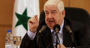 "Syrian foreign minister Walid al-Moallem speaks during a press conference in Damascus yesterday. He said his country had defences that would ""suprise"" its antagonists. Photograph: AP"