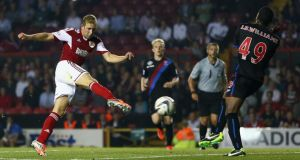 Scott Wagstaff  of Bristol City fires his side's second goal past Jerome Binnom-Williams  of Crystal Palace during the Capital One Cup second round match  at Ashton Gate. Photograph: Michael Steele/Getty Images