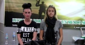 Irish woman, Michaella McCollum Connolly (left) (20), and British woman Melissa Reid (19), stand as they are being questioned by police in Lima in this still image taken video provided by the police.