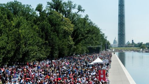 People arrive at the National Mall in Washington DC on Saturda to celebrate the 50th anniversary of Dr Martin Luther King Jr.'s 'I have a Dream' speech. Photograph: Pete Marovich/Getty Images