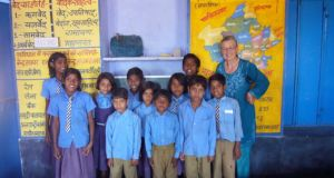 Sara McMurray with  pupils in southeast Rajasthan, India. Students constituted 40 per cent of all volunteers from Ireland last year, while employed people made up 44 per cent, a new report reveals