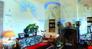 The villa's living room with frescoes by Jean Cocteau