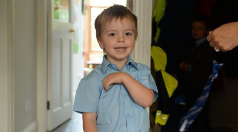 Rossa Moore (4) getting ready at home in Sandymount, Dublin for his first day in school. Photograph: Frank Miller / The Irish Times