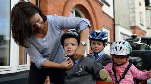 Niamh adjusts Rossa's helmet before setting off.   Photograph: Frank Miller / The Irish Times