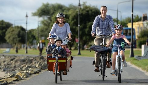 The Moore family travel along the seafront in Sandymount, the safest route to the school. Photograph: Frank Miller / The Irish Times