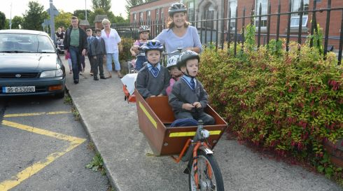 Rossa, in front of carrier,  arrives at Star of the Sea primary school, Sandymount. Photograph: Frank Miller / The Irish Times