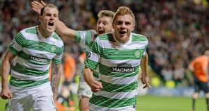 Celtic's reward for their play-off win over Shakhter Karagandy is a place in Group H alongside Barcelona, AC Milan and Ajax. Photograph: Jeff J Mitchell/Getty Images