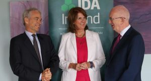Paul van Riel, chief executive of Dutch multinational Fugro, with Minister for Social Protection Joan Burton and Barry O'Leary, IDA chief executive. Photograph: Kenneth O'Halloran