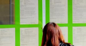 A woman look at information boards in the window of the Job Centre Plus in Derbyshire. Figures released today show the EU unemployment rate was 11 per cent in July and 12.1 per cent in the eurozone. Photograph: PA Wire.