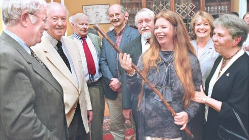 The poet Nuala Ni Dhomhnaill receiving the Parnell whitethorn walking stick from the Nobel laureate poet Dr Seamus Heaney (left),at a private ceremony in the RDS in 1998. Also at the presentation were from left: Dr Conor Cruise O'Brien (a former custodian of the Stick), author Tom Flanagan, publisher and poet Peter Fallon, Dogan Leflef (husband of the poet), Marie Heaney, and poet  Máire Mhac an tSaoi . Photograph: Matt Kavanagh/The Irish Times