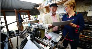 Author Domhnall (Danny) Mac Sithigh and Dominique Lieb who print books using the Gutenberg letterpress technique with original linoprints in her studio in Dingle, Co Kerry. Photograph: Bryan O'Brien
