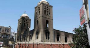 An Evangelical church, located about 245km (152 miles) south of Cairo, was recently burnt out. Photograph: Reuters