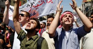 Protesters from leftist parties shout slogans during a demonstration against military strikes on the Syrian government and to show their support for the regime of Syrian president Bashar al-Assad, after Friday prayers in Amman yesterday. Photograph: Majed Jaber/Reuters