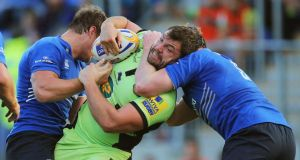 Leinster's Jordi Murphy and Tom Denton tackle Alex Corbisiero of Northampton in Donnybrook. Photograph: Cathal Noonan/Inpho