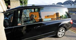 A hearse carrying the remains of poet Seamus Heaney arrives at the Church of the Sacred Heart in Donnybrook. Photograph: Dave Meehan.