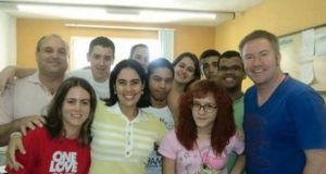 Michael Lynn (far right) at the school where he was teaching in Brazil.