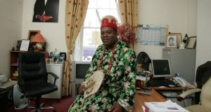Matthew Emeka Ezeani, in traditional Igbo dress,  in his office on Gardiner Street where he practised as a solicitor. Photograph: Frank Miller
