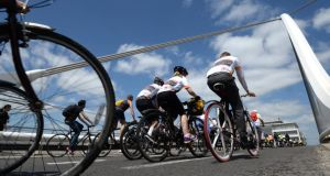 People take part in the Bike to Work Lunchtime Cycle in Dublin. Photograph: Dara Mac Dónaill/The Irish Times