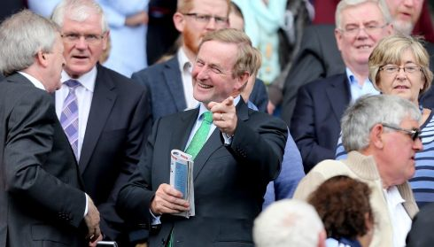 One o' the lads: Taoiseach Enda Kenny havin' the craic. Photograph: James Crombie/Inpho