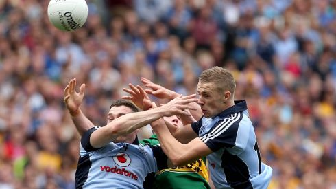 Hands all over the place: Dublin's Paul Mannion and Paddy Andrews with Mark Griffin of Kerry. Photograph: Ryan Byrne/Inpho