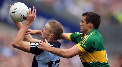 Dublin's Paul Mannion and Shane Enright of Kerry. Photograph: Cathal Noonan/Inpho