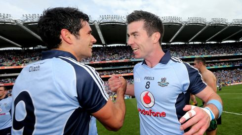 Dublin's Cian O'Sullivan and Michael Darragh MacAuley celebrate after the game. Photograph: James Crombie/Inpho