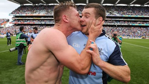 Ahh dude! Dublin's Paul Flynn kisses Kevin McManamon in celebration after the game. Photograph: Cathal Noonan/Inpho