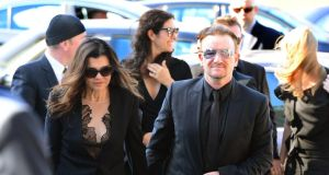 U2 singer Bono and his wife Ali Hewson arrive at the Church of the Sacred Heart, Donnybrook for the funeral of Seamus Heaney this morning. Photograph: Bryan O'Brien/The Irish Times