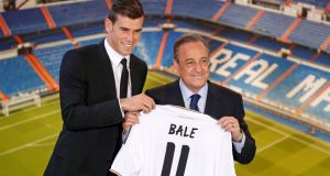 Gareth Bale (L) of Wales hold his new Real Madrid soccer club jersey accompanied by president Florentino Perezat the Santiago Bernabeu stadium in Madrid. Photograph:  Paul Hanna/Reuters