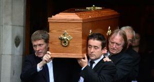 The coffin containing the remains of poet Seamus Heaney is carried from the Sacred Heart Church in Donnybrook after his funeral Mass this morning. Photograph: Bryan O'Brien/The Irish Times