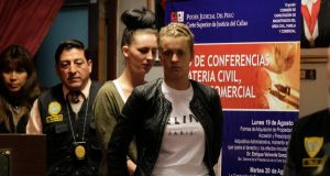 Michaella McCollum Connolly (2nd right) and Melissa Reid (right), arrested on suspicion of smuggling cocaine out of the country, are escorted by police as they enter the Justice Court of Callao last month. Photograph: Mariana Bazo/Reuters