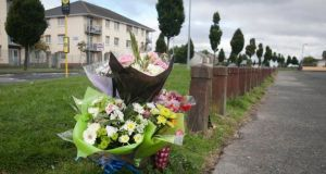 Flowers at the scene of the  fatal shooting of Dean Johnson on Harelawn Green, Clondalkin. Photograph: Gareth Chaney/Collins