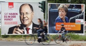 Election campaign billboards featuring SPD chancellor candidate Peer Steinbrueck and German Chancellor and CDU leader Angela Merkel  in Berlin, Germany. Photograog: Sean Gallup/Getty Images