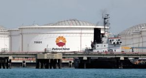 PetroChina Co storage tanks  in Singapore - China's corruption watchdog opened a probe into Jiang Jiemin,  former chairman of China National Petroleum Corp. Photographer: Munshi Ahmed/Bloomberg