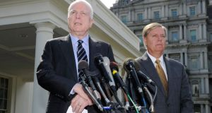 US senators John McCain and Lindsey Graham after meeting with US President Barack Obama on possible military action against Syria. Photograph: Mike Theiler/Reuters.