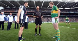 Referee Cormac Reilly with captain's Stephen Cluxton and Colm Cooper before the game