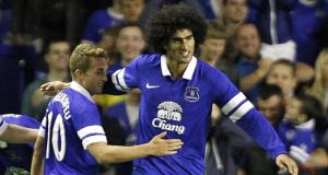 Everton's Marouane Fellaini (right) has been sold to Manchester United for €32.5m. Photograph: Peter Byrne/PA Wire