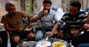 Free Syrian Army fighters eating together in Aleppo yesterday. Photograph: Hamid Khatib/Reuters