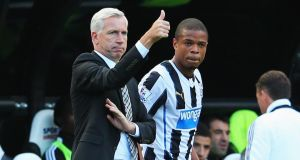 Newcastle United manager Alan Pardew and Loic Remy as the new signing prepares to come on against Fulham last weekend.  Photograph:  Julian Finney/Getty Images