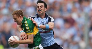 Dublin's Michael Darragh Macauley tackles Kerry's Colm Cooper. Photo: Cathal Noonan/Inpho